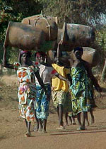Women carrying water in Benin