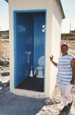 Courtest of WEDC, photo of woman at a latrine in Ghana