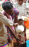 African girl washing hands